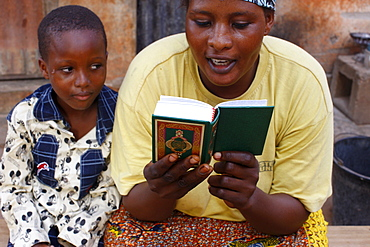 African mother reading the Koran, Lome, Togo, West Africa, Africa