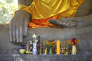 Buddha statue in earth-touching pose, with offerings, Siem Reap, Cambodia, Indochina, Southeast Asia, Asia