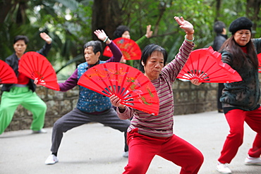 Tai-chi exercises with fans, Macau, China, Asia