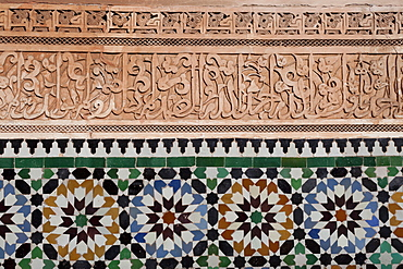 Calligraphy and zellige in the patio of the Medersa Ben Yousef, built in 1570, the biggest Koranic school in the Maghreb, Marrakesh, Morocco, North Africa, Africa