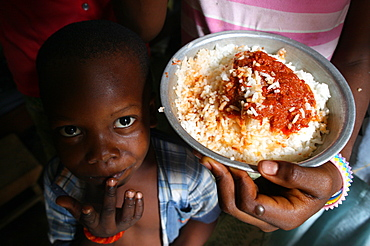 Children eating an African meal, Lome, Togo, West Africa, Africa