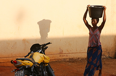 Woman carrying water, Lome, Togo, West Africa, Africa