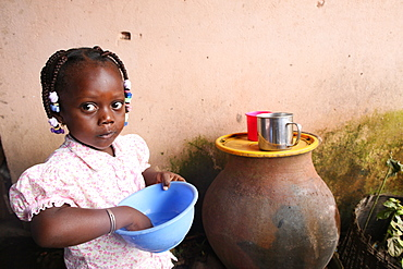 Girl eating a meal, Lome, Togo, West Africa, Africa