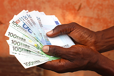 African holding Euros, Lome, Togo, West Africa, Africa