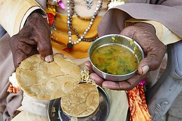 Sadhu eating vegetarian food, Dauji, Uttar Pradesh, India, Asia