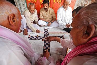 Senior men playing a game, Mathura, Uttar Pradesh, India, Asia