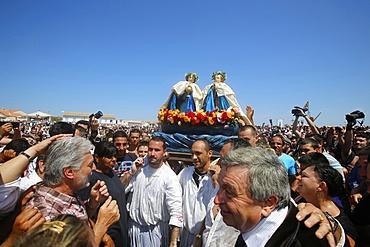 Procession with statues of patron saints Marie Jacobe and Marie Salome, Gypsy pilgrimage at Les Saintes-Maries-de-la-Mer, Bouches du Rhone, France, Europe