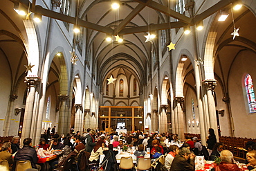 Christmas meal offered by the Sant'Egidio community in Saint-Hippolyte church, Paris
