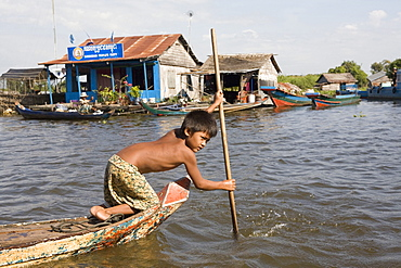 Young boy in a boat on Tonle Sap Lake, Cambodia, Indochina, Southeast Asia, Asia