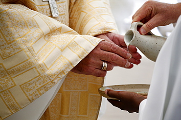 Priest washing hands, Catholic Mass, La Roche-sur-Foron, Haute-Savoie, France, Europe