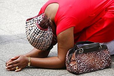 Praying woman, Lourdes, Hautes Pyrenees, France, Europe