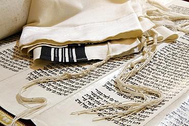 Torah scroll, Tallit, Jewish prayer shawl and Tziitzit, knotted ritual fringes, Paris, France, Europe