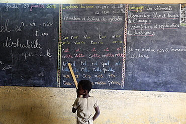 Pupil at the blackboard, primary school, Lome, Togo, West Africa, Africa
