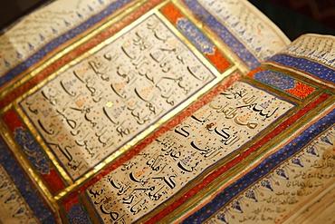 Quran from the 15th century in India, Institut du Monde Arabe (Arab World Institute) Exhibition on the Hajj (Islamic pilgrimage to Mecca). Paris, France, Europe