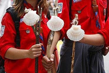 Scouts with Santiago pilgrimage scallop shells, Lourdes, Hautes Pyrenees, France, Europe
