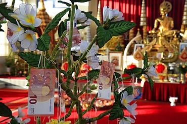Offerings on a tree, Wat Velouvanaram, Bussy St. George, Seine et Marne, France, Europe