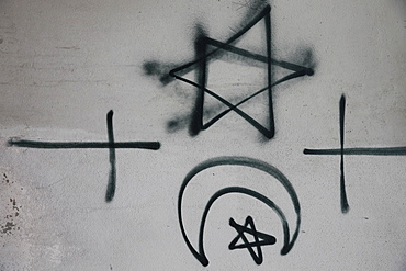Religious symbols tagged on a wall, Montrouge, Hauts-de-Seine, France, Europe