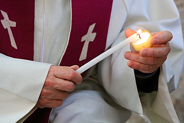 Lighting a candle on Day celebration of forgiveness, Amiens Cathedral, Picardy, France, Europe