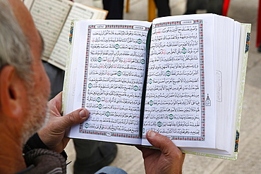 Palestinians reading the Koran outside Al-Aqsa mosque, Jerusalem, Israel, Middle East