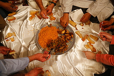 Muslims sharing a meal, Nandy, Seine-et-Marne, France, Europe