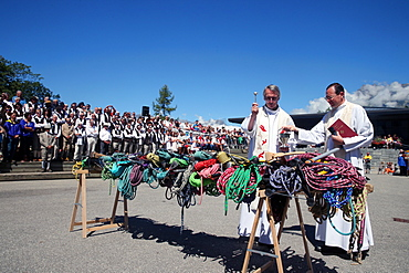 Priest blessing ice picks and ropes, Saint-Gervais traditional mountain guides festival, Saint-Gervais-les-Bains, Haute Savoie, France, Europe