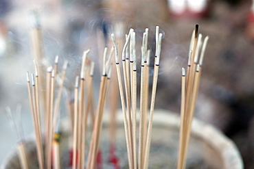 Close-up of incense sticks burning, Wat Si Muang (Simuong) Buddhist temple, Vientiane, Laos, Indochina, Southeast Asia, Asia