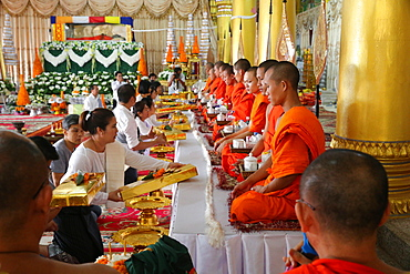Seated Buddhist monks chanting and reading prayers at a ceremony, Wat Ong Teu Buddhist Temple, Vientiane, Laos, Indochina, Southeast Asia, Asia