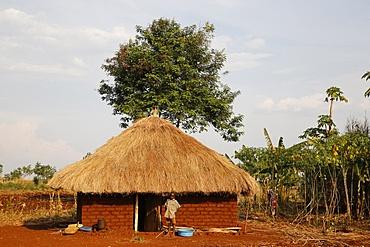 Ugandan child outside his home, Bweyale, Uganda, Africa