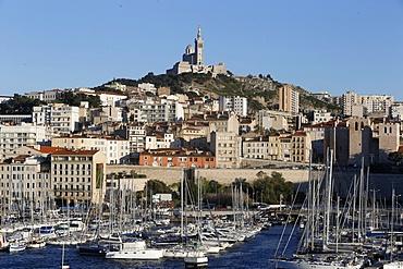 Marseille old harbour and Notre Dame de la Garde Basilica, Marseille, Bouches-du-Rhone, Provence-Alpes-Cote d'Azur, France, Europe