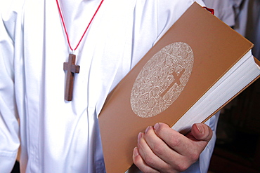 Altar boy with Holy Bible during Catholic Mass, Haute-Savoie, France, Europe