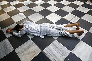 Hindu devotee prostrating at Krishna-Balaram temple, Vrindavan, Uttar Pradesh, India, Asia