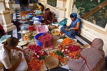 Devotees making garlands at Krishna-Balaram Hindu temple, Vrindavan, Uttar Pradesh, India, Asia