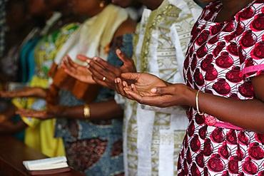 Prayer, Sunday morning Catholic Mass, Lome, Togo, West Africa, Africa