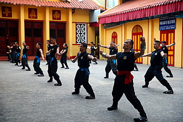 Men practising martial arts in a Buddhist temple, Ho Chi Minh City, Vietnam, Indochina, Southeast Asia, Asia