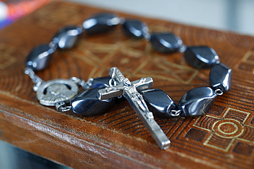 Rosary beads on an old Bible, Ho Chi Minh City, Vietnam, Indochina, Southeast Asia, Asia
