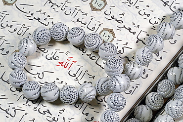 Quran and Tasbih (prayer beads), with Allah monogram in red, Haute-Savoie, France, Europe