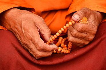 Tibetan monk holding prayer beads, Nepal, Asia