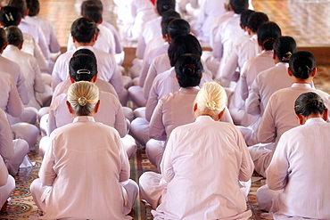 Praying devout women, ceremonial midday prayer, Cao Dai Holy See Temple, Tay Ninh, Vietnam, Indochina, Southeast Asia, Asia
