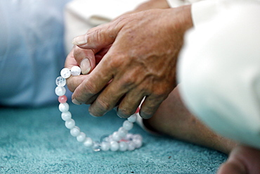 Close-up of man praying in a mosque with Tasbih (prayer beads), Masjid Al Rahim Mosque, Ho Chi Minh City, Vietnam, Indochina, Southeast Asia, Asia