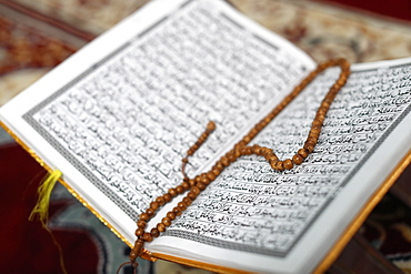 Arabic Holy Quran (Koran) with prayer beads (tasbih), Jamiul Islamiyah Mosque, Ho Chi Minh City, Vietnam, Indochina, Southeast Asia, Asia