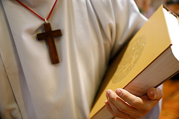 Altar boy with Holy Bible, Catholic Mass, Sallanches, Haute-Savoie, France, Europe