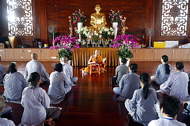 A teacher instructs a group of people how to recite Buddhist chants, Minh Dang Quang Buddhist Temple, Ho Chi Minh City, Vietnam, Indochina, Southeast Asia, Asia