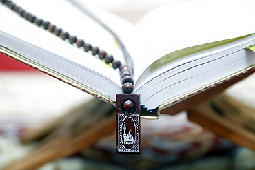 Holy Quran and Muslim prayer beads on wood stand, Hanoi, Vietnam, Indochina, Southeast Asia, Asia