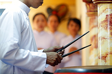 Cao Dai worshipper playing drums, Cao Dai Temple, Phu Quoc, Vietnam, Indochina, Southeast Asia, Asia