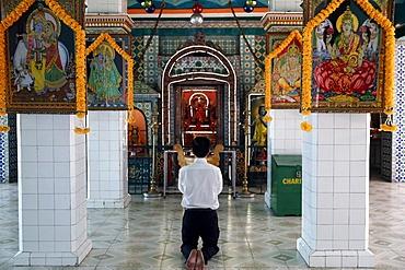 Worshipper praying, Sri Thenday Yutthapani Temple, Ho Chi Minh City, Vietnam, Indochina, Southeast Asia, Asia