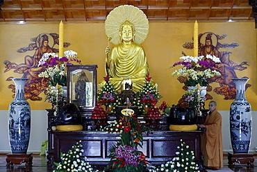 Main altar with Buddha statue and monk, Truc Lam Buddhist temple, Dalat, Vietnam, Indochina, Southeast Asia, Asia