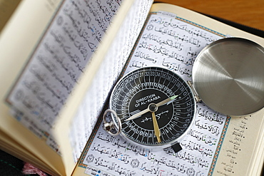 Quran and a Qibla compass to indicate the direction of Mecca, Vietnam, Indochina, Southeast Asia, Asia