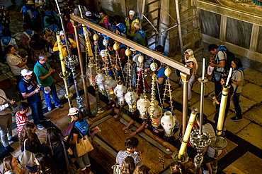 Christian pilgrims and tourists at the Church of the Holy Sepulchre, Jerusalem, Israel, Middle East