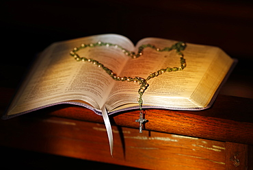 Open Bible and rosary in a church, Haute-Savoie, France, Europe