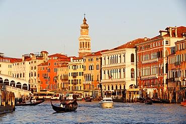 Gondolier on gondola on Grand Canal at sunset, Venice, UNESCO World Heritage Site, Veneto, Italy, Europe